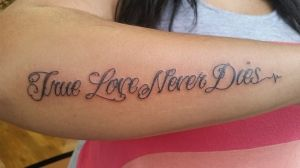 cursive lettering tattoo